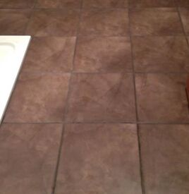 One box of 9 Brown Floor tiles 1m squared
