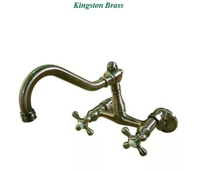 Kingston Brass Vintage Double Handle Wall Mount Kitchen Faucet in Vintage Brass