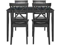 Glass table and 4 cross back wooden chairs--black