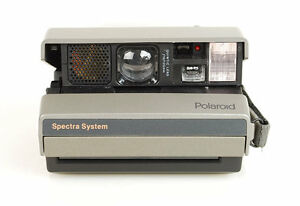 Vintage Polaroid Spectra Instant Camera and New Film Pack