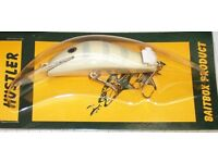4 FISHING LURES. NEW.