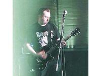Mature guitarist seeks gigging Punk band.