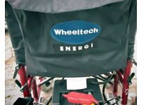 Electric wheelchair by Wheeltech 'Enigma' model in red