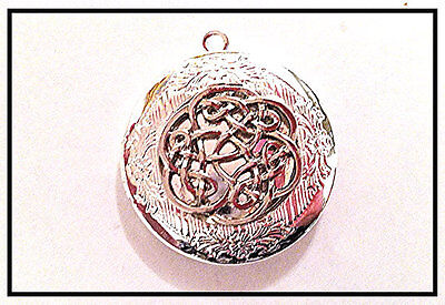 - IRISH CELTIC KNOT Round Silver Plated Photo Locket on sterling 925 Chain