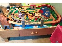 AS NEW- HUGE TRAIN TABLE - 100+ pieces such as cars, trucks, people and more.
