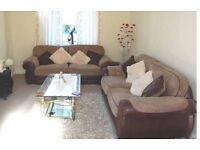 2x 2 seater sofa's brown
