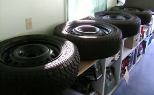 "Four - 17"" Mounted Snow Tires For Sale"