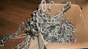 "Tire Chains New in box. 23x10.5x12.  7/32"" - 4 link"