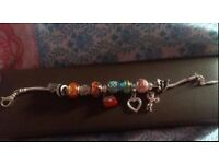 Beaverbrook bracelet and charms