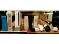Nintendo Wii home console with 7 games and accessories bundle