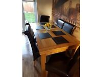 Dining Table - Solid Oak and 8 chairs - dark brown leather