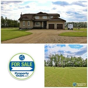 Acreage 8 minutes east of Innisfail with Custom Home!