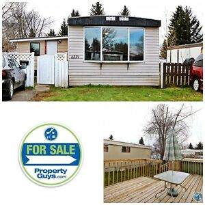 REDUCED! Upgraded mobile on large lot in Mustang Acres!!