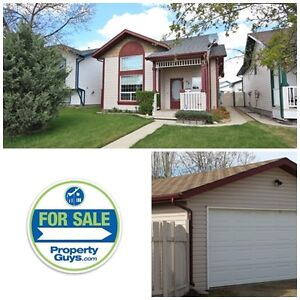 REDUCED! 3 Level split with a Det garage in Kentwood!