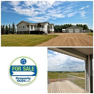 Acreage life with city comfort! Stettler