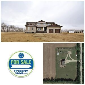 Acreage with custom 2 storey! Shop services in place, Innisfail