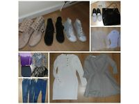 bundle of clothes and shoes