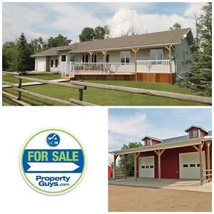 Acreage with shop, barn, tack room with bar and exec home!