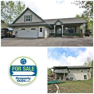 ANOTHER HUGE REDUCTION! Acreage minutes from Red Deer!