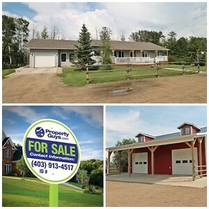 REDUCED! Immaculate Acreage only 15 minutes South of Red Deer.