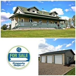 REDUCED! Acreage with Gorgeous custom home!