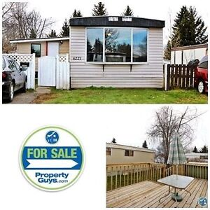 Large lot, parking, shed, spacious deck & more!