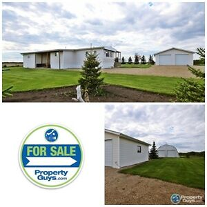 Three beautiful fenced acres! Greenhouse, det gar & quonset!