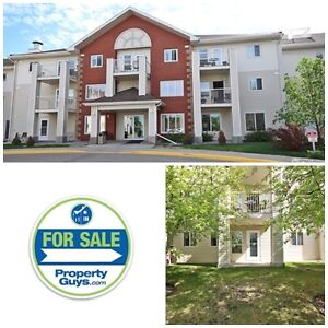 60 plus ground floor condo in Legacy Estates! Well maintained!
