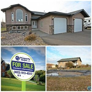 Bi-level home with attached garage! Acreage in Innisfail