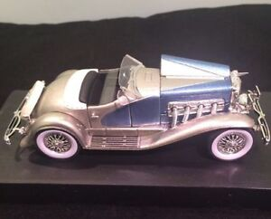 1935 Deusenberg SJ convertible with top down; in 1/32 scale