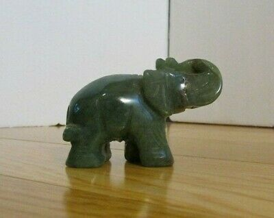 Chinese hand carved jade Elephant figurine on wooded stand.