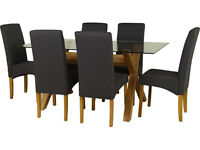 Heatley Glass DIning table with 6 Black CHairs