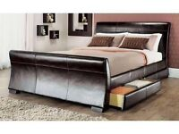 5ft King size faux leather bed with 4 pull out drawers and mattress in excellent condition.