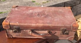 Vintage distressed leather suitcase
