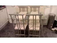 Glass Table with 4 Chairs and place matts