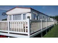 4 bed static caravan with decking, storage shed, 2016 site feeds and exchange of ownership fees paid