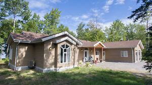 6 Acres of Waterfront Property with Bungalow