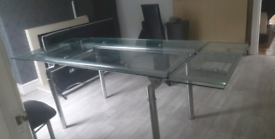 Glass extendable dining room table & 6 chairs