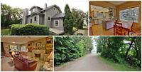 Acreage in Penhold with home/garage