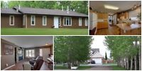 An acreage, in the city! Lacombe