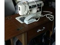 NewHome sewing machine with built-in table