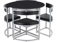 New Bargain as 1 faint mark Space saver table and chairs. Boxed Can deliver.