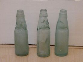3 bottles with marbles