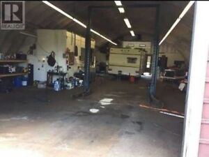 Mechanic shop for sale with property