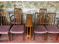 **£95** Vintage Teak Fold Down Dining Table with 6 Chairs (including 2 Carvers)