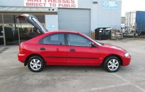 1998 Ford Laser KJIIL GLXi Flame Red 4 Speed Automatic Hatchback Epping Whittlesea Area Preview