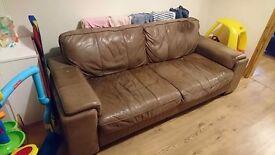 Large brown three seater sofa