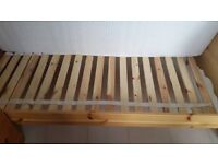 Wooden single bed, with mattress. Almost brand new.