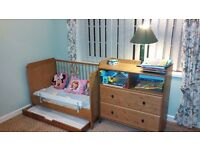 Ikea cot with a chest of drawers and some add-ons