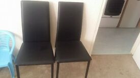 New black glass dining table with 4 chairs